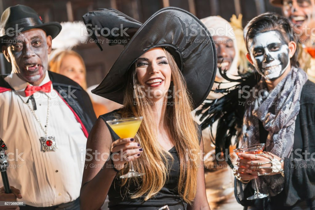 Adult halloween party, witch drinking stock photo