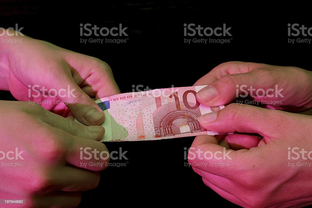 Adult hands trying to get 10 euros royalty-free stock photo