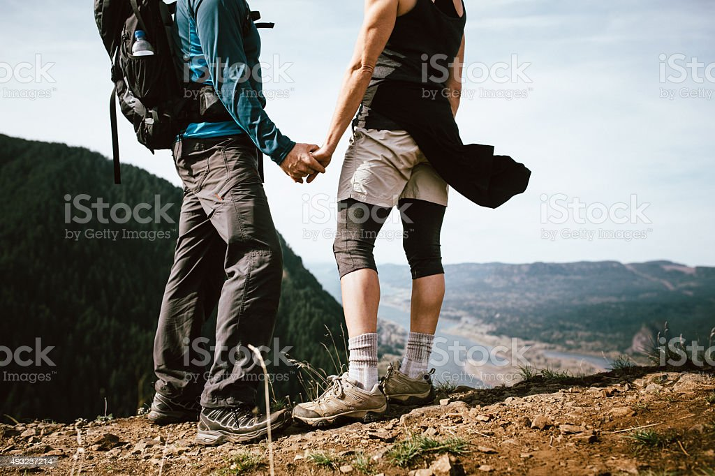 Adult Hikers on Mountain Top stock photo