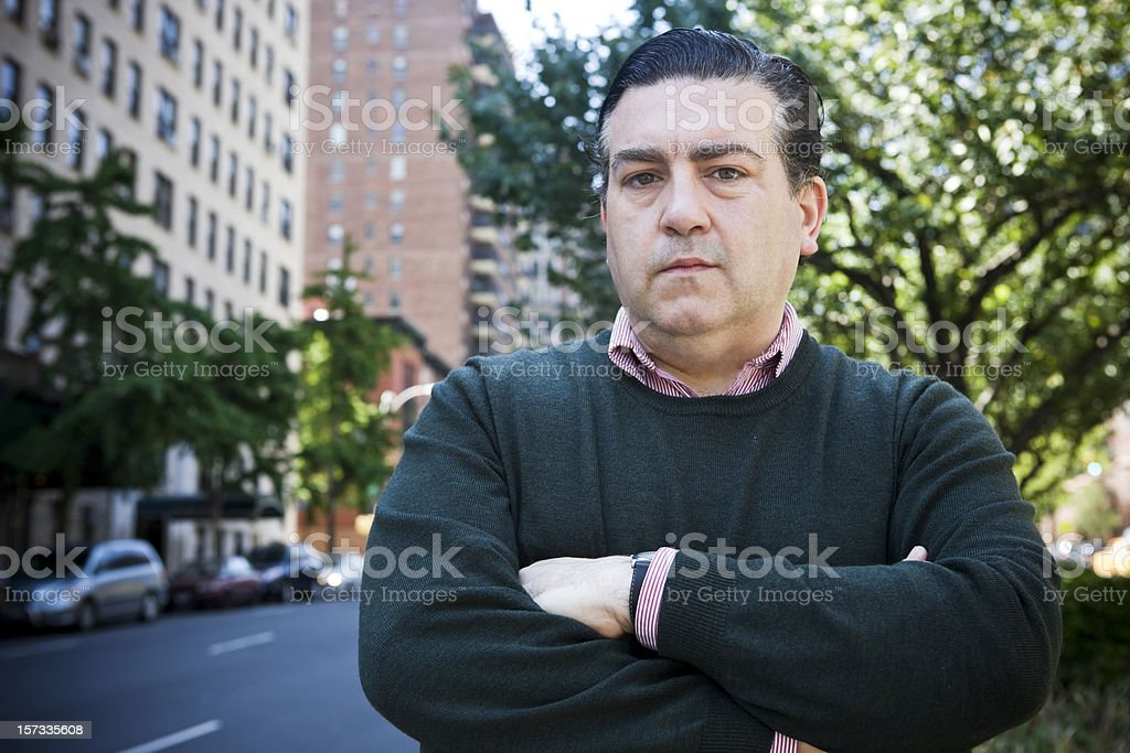 Adult Italian American Man Portrait Crossing Arms on City Sidewalk royalty-free stock photo
