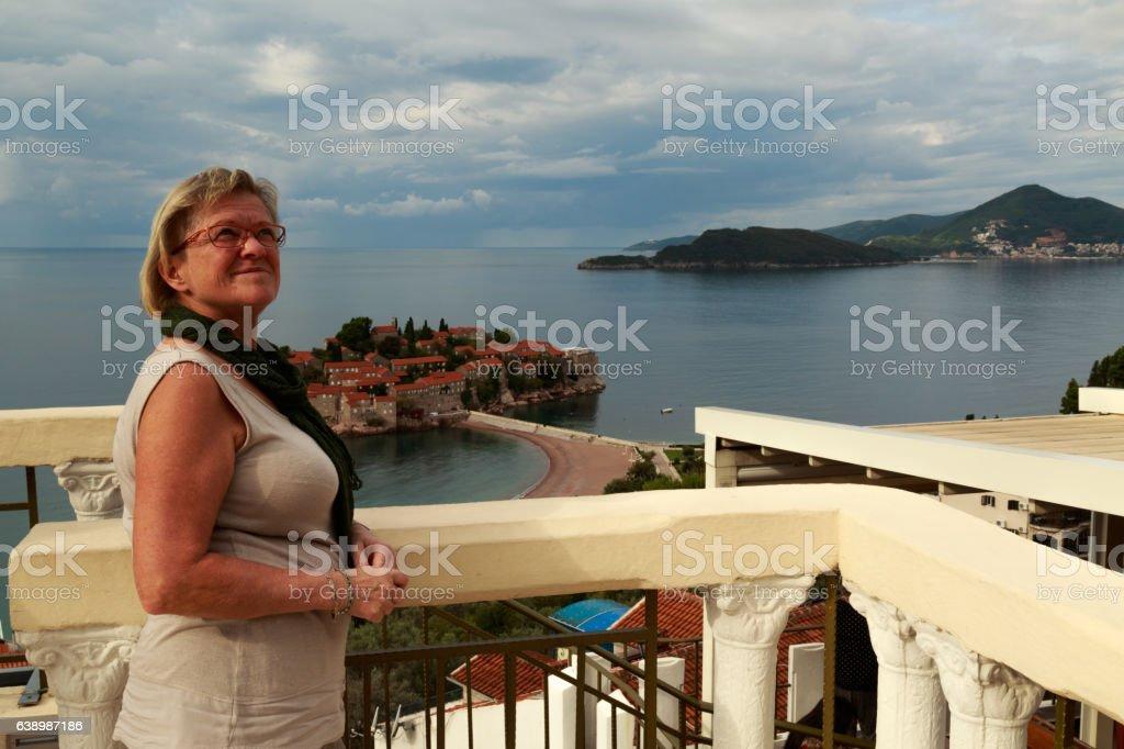 adult lady near Sveti Stefan stock photo