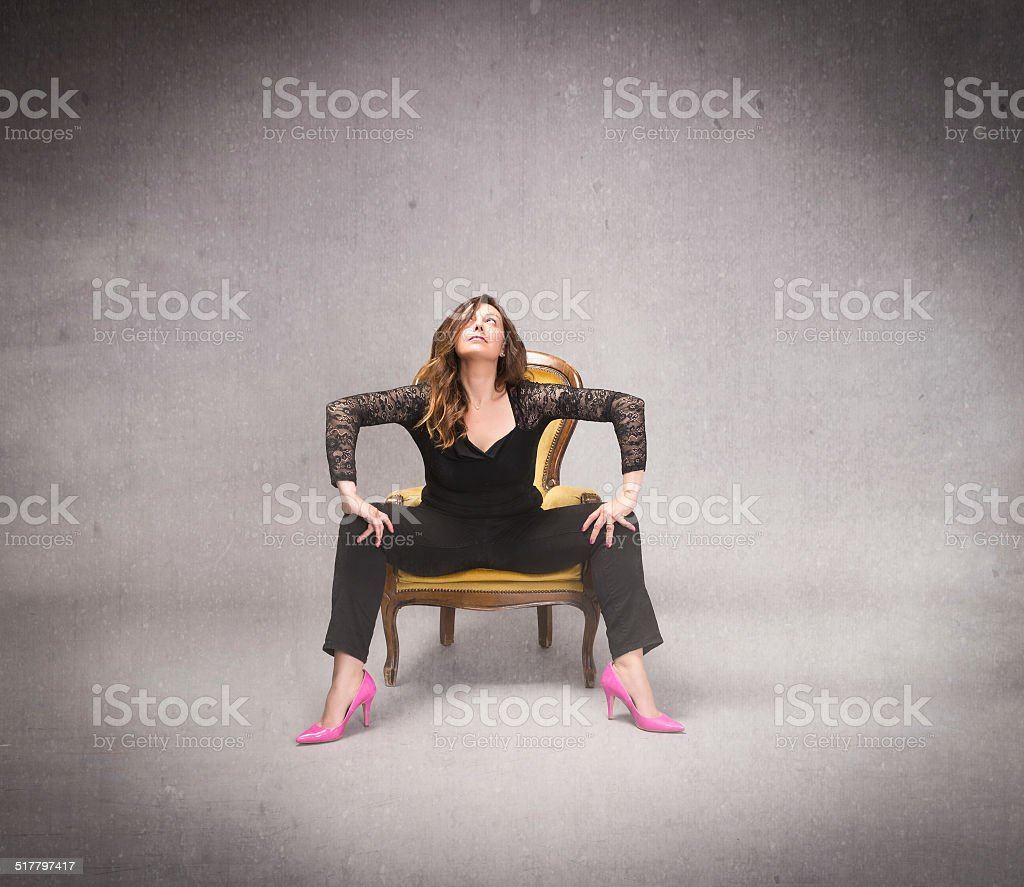 adult lady sitting with opens legs and high heels stock photo