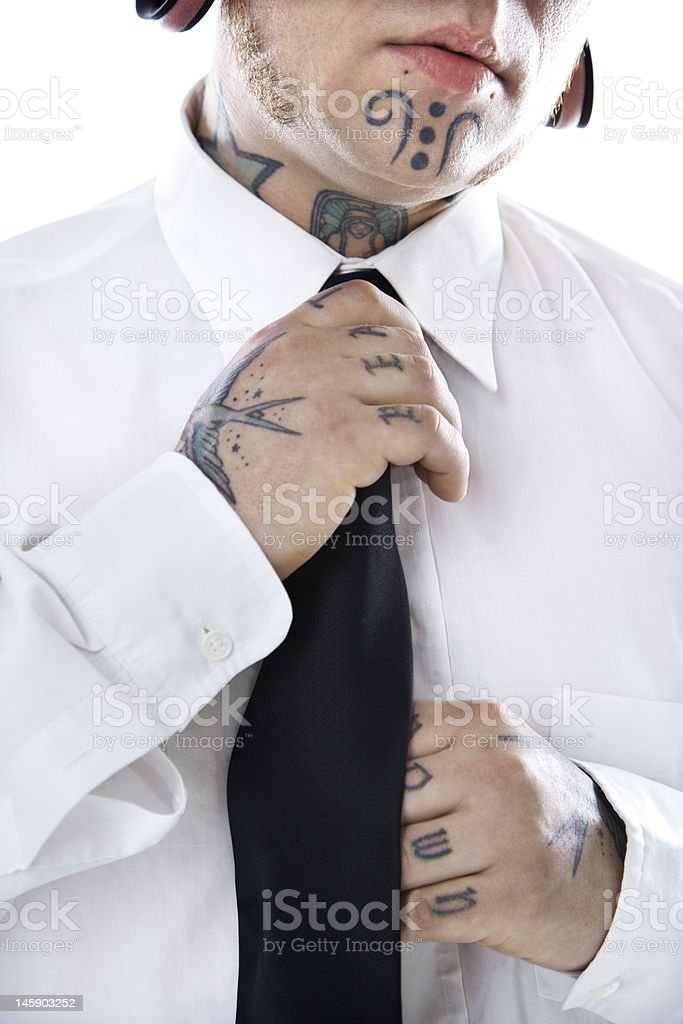 Adult male adjusting necktie. royalty-free stock photo