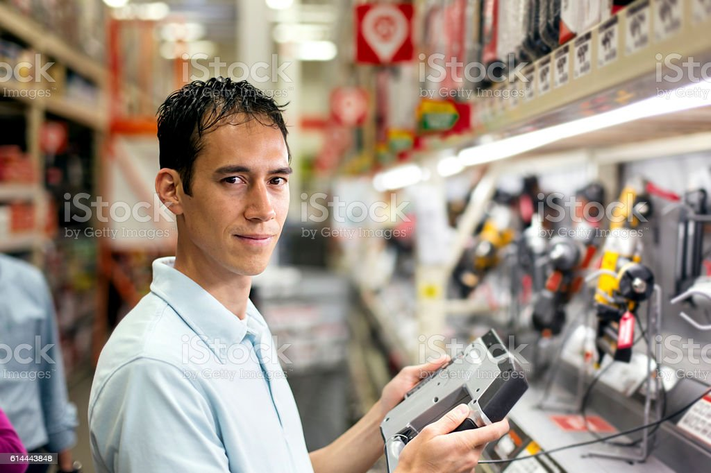 Adult male deciding what tools to purchase stock photo
