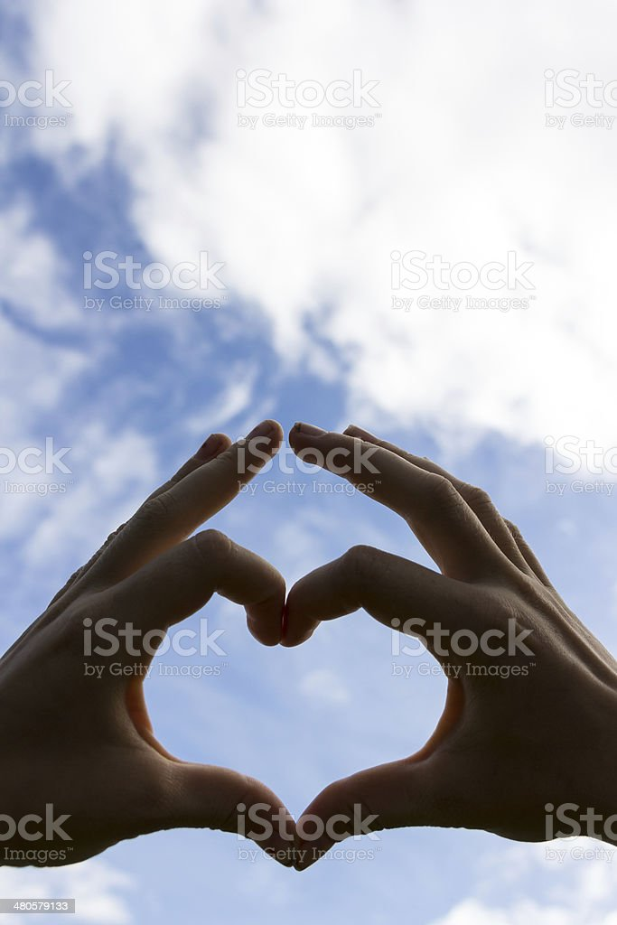 Adult male hands shows heart shape. royalty-free stock photo
