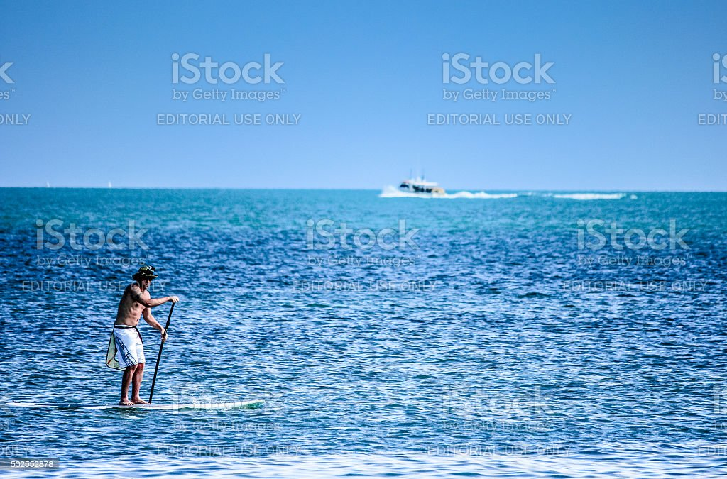 Adult male paddle-boarding in Key West, Florida stock photo
