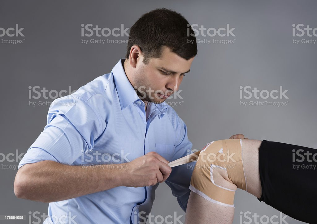 Adult male physiotherapist royalty-free stock photo