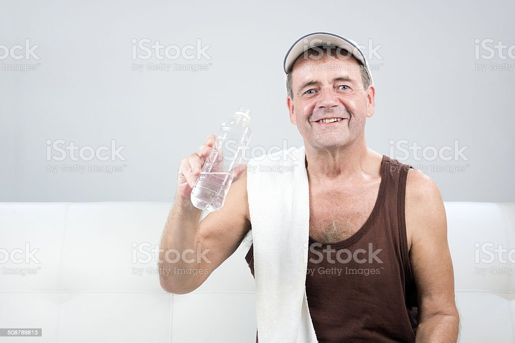 Adult Male Relaxes After Exercising. stock photo