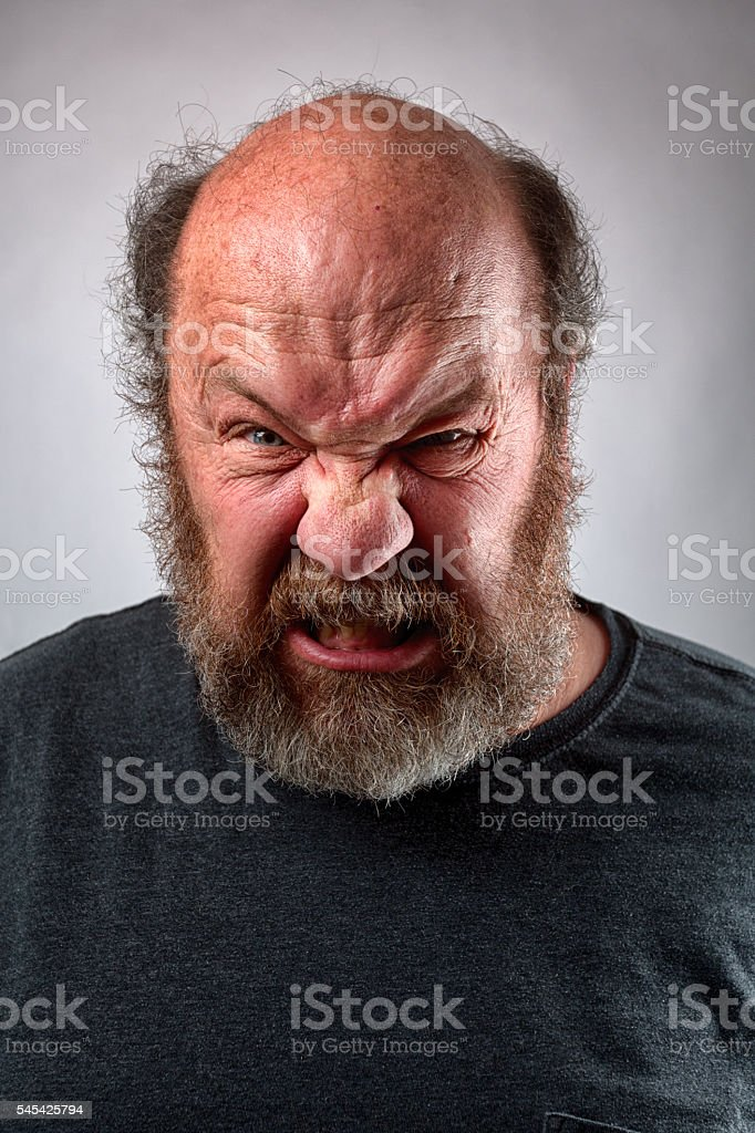 Adult Male Showing Intense Expression Of Emotion stock photo