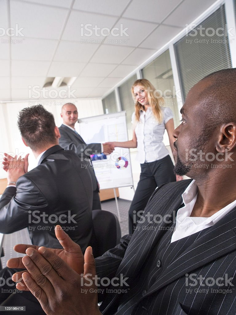 Adult male students applauding their presenters at a seminar royalty-free stock photo