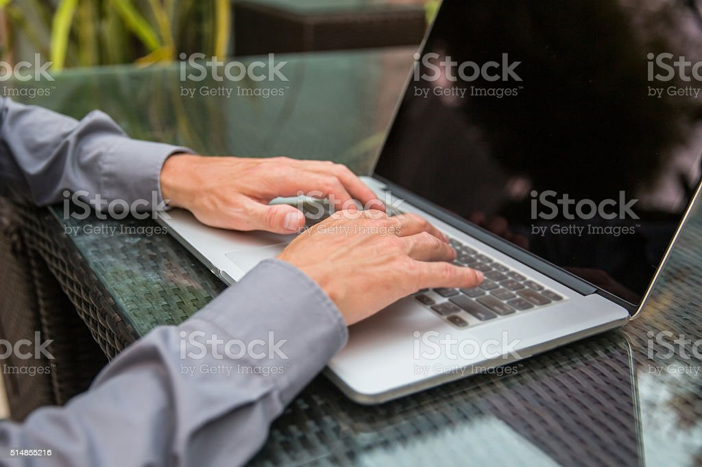 Adult male using laptop for work stock photo