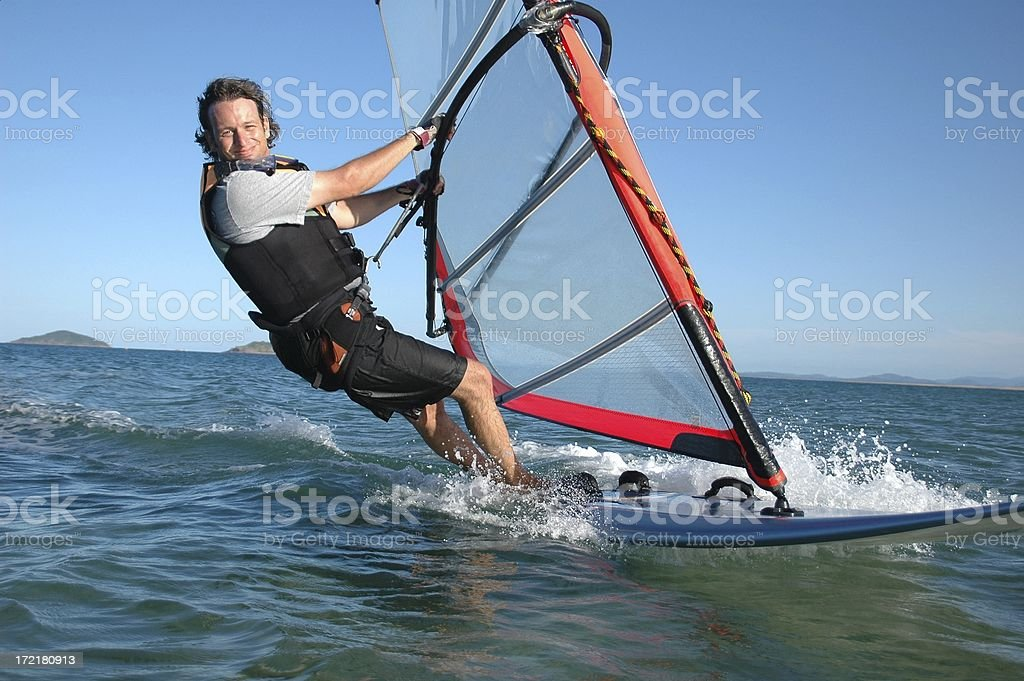 Adult male windsurfing fun! stock photo