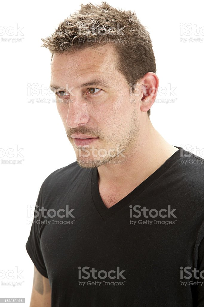 Adult male with serious expression wearing black shirt stock photo
