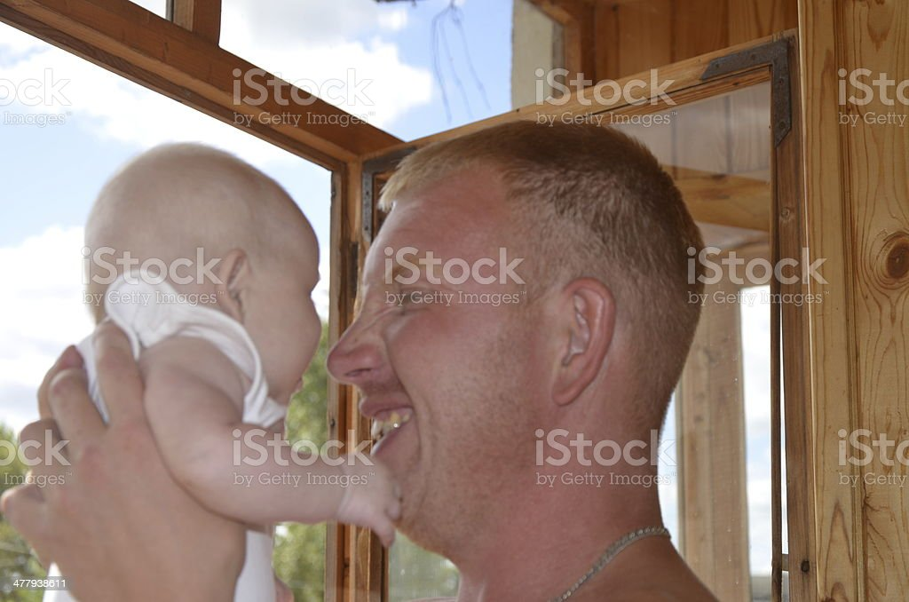 Adult man and young baby royalty-free stock photo