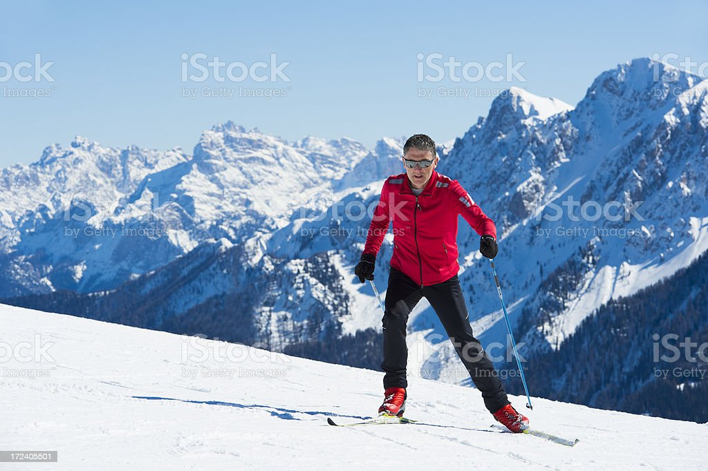 Adult man at cross country skiing in the mountains royalty-free stock photo