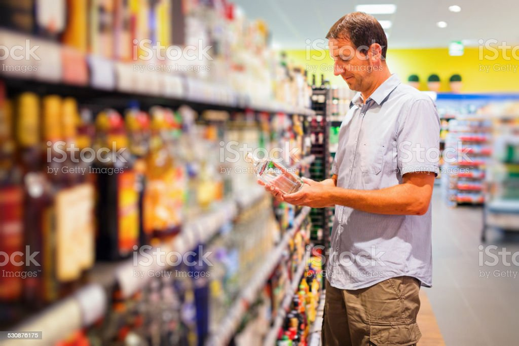 adult man at the supermarket stock photo