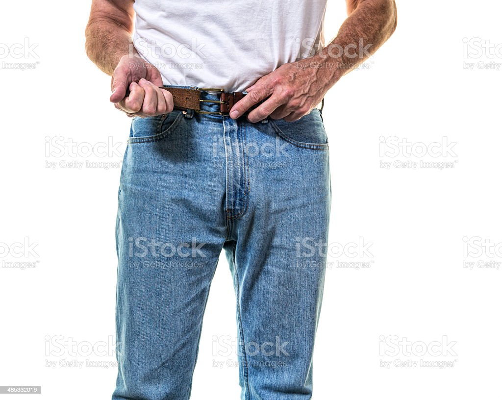 Adult Man Buckling Belt Getting Dressed stock photo