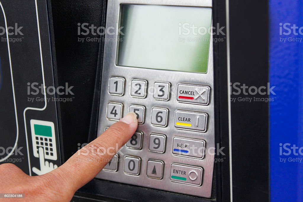 Adult man buying train ticket from vending machine stock photo