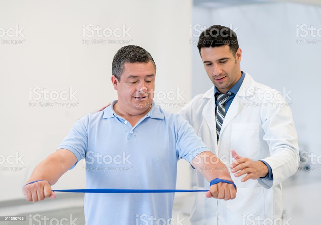 Adult man doing physiotherapy stock photo
