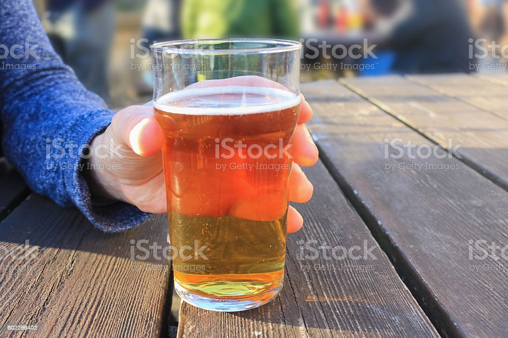 Adult man drinking beer in summer stock photo