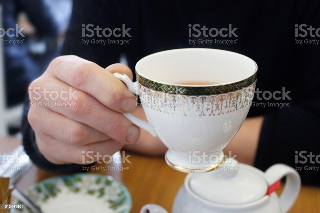 Adult man drinking hot tea stock photo