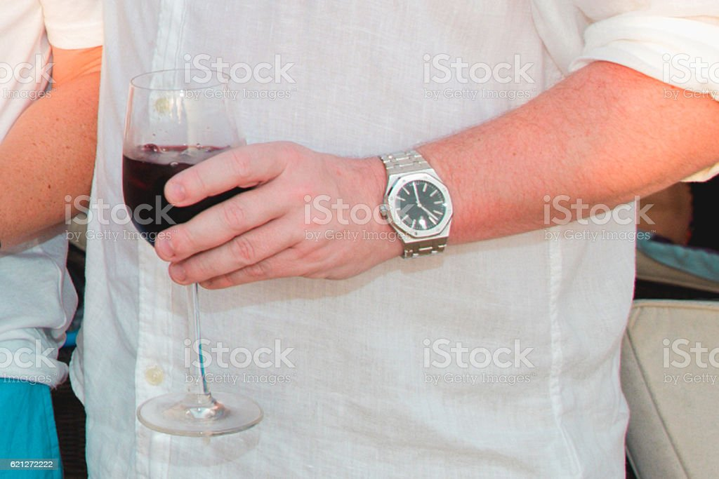 Adult man drinking red wine stock photo