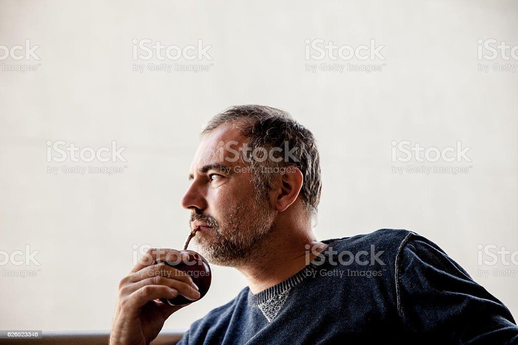 Adult man Drinking Yerba Mate stock photo