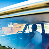 Adult Man Driving His Vintage Car At Daytime