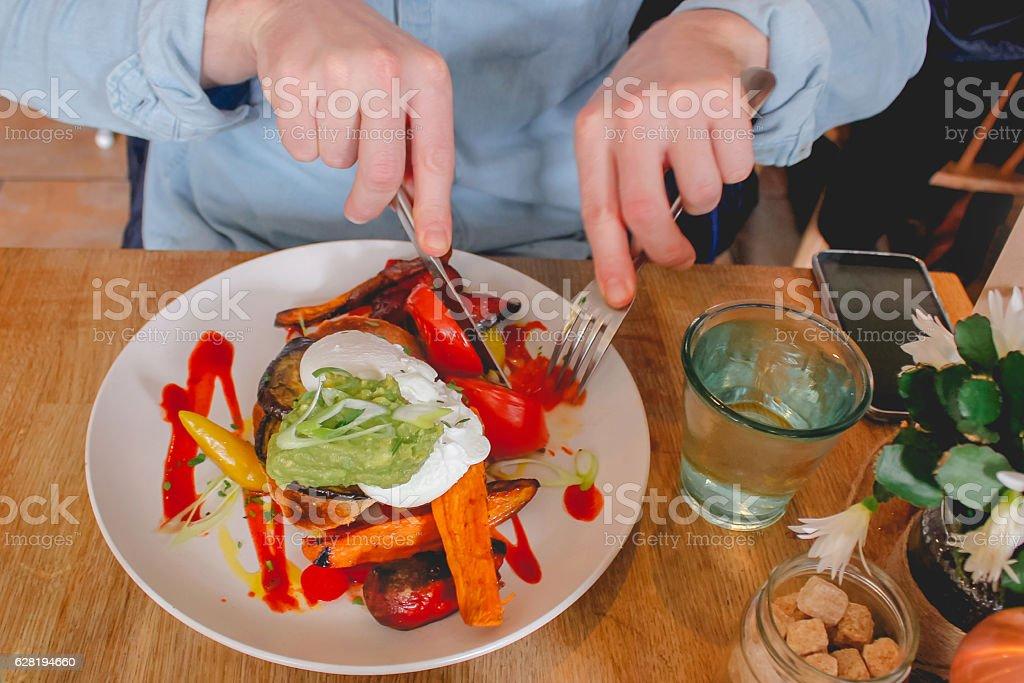 Adult man eating healthy breakfast stock photo