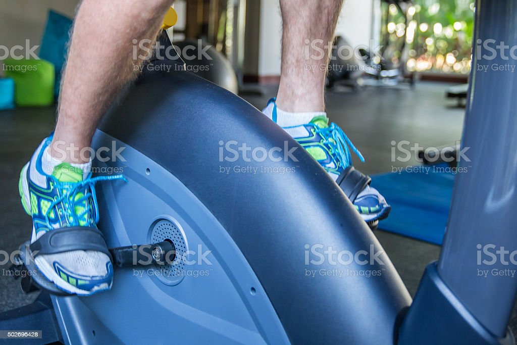 Adult man exercise at gym stock photo
