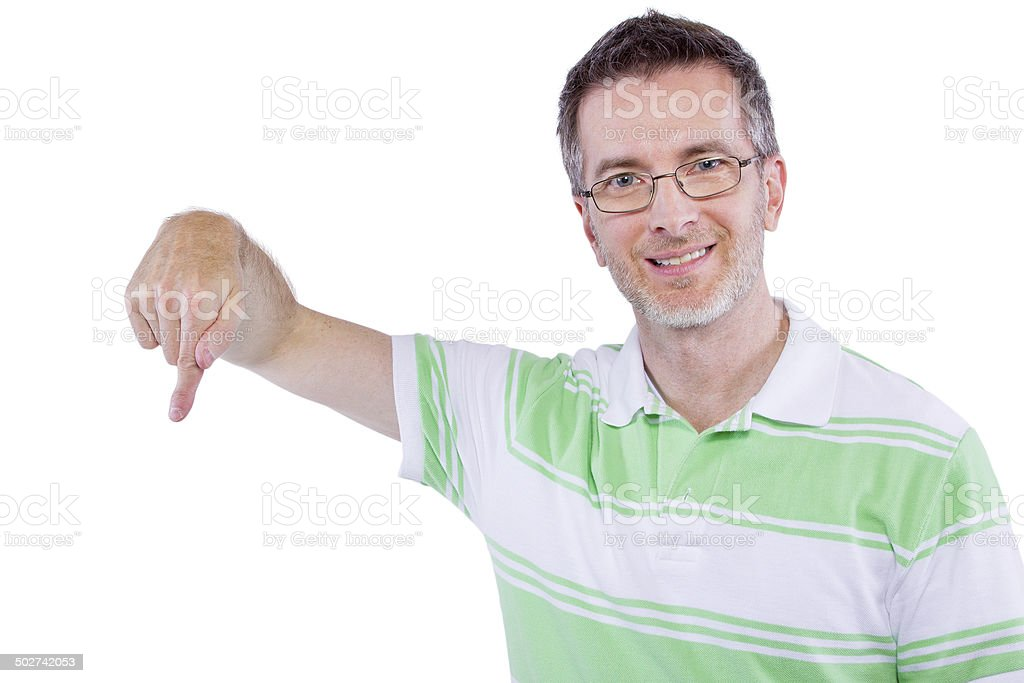 Adult man in green shirt with advertising gestures stock photo