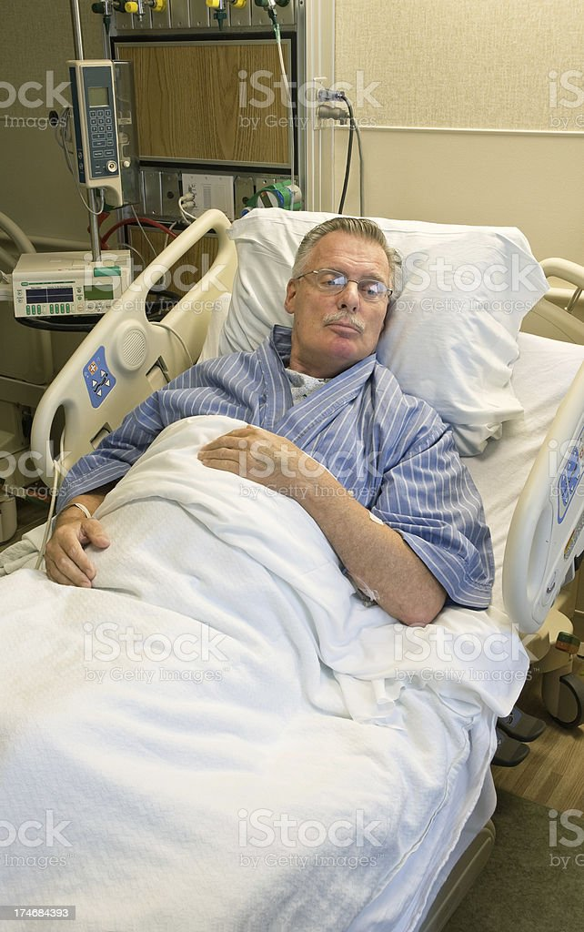 adult man in hospital room recuperating royalty-free stock photo
