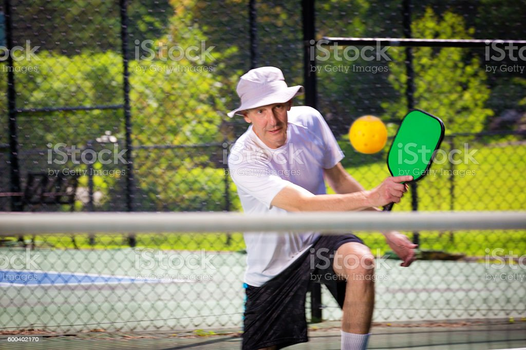Adult Man Pickleball Player Playing Pickleball in Court stock photo