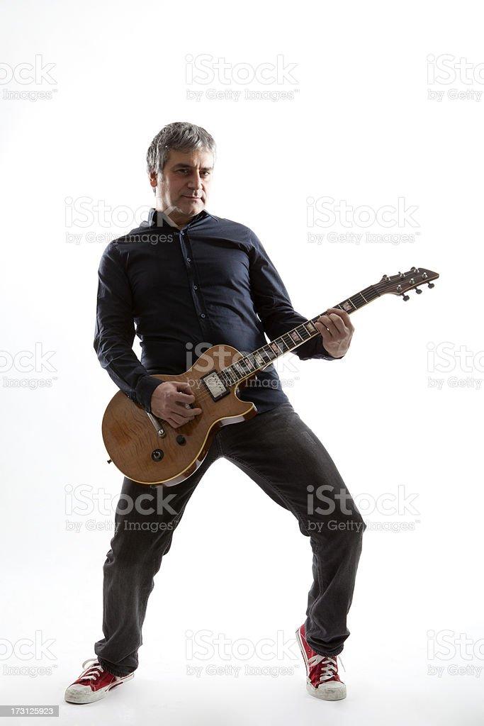 Adult man playing guitar stock photo