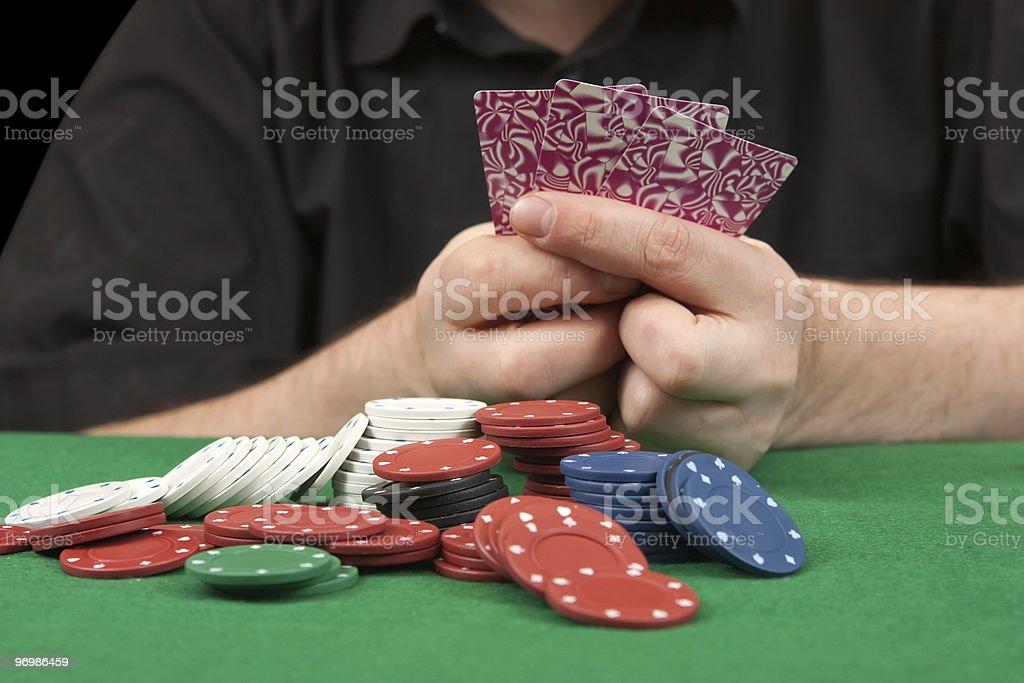 adult man playing poker .close-up. stock photo
