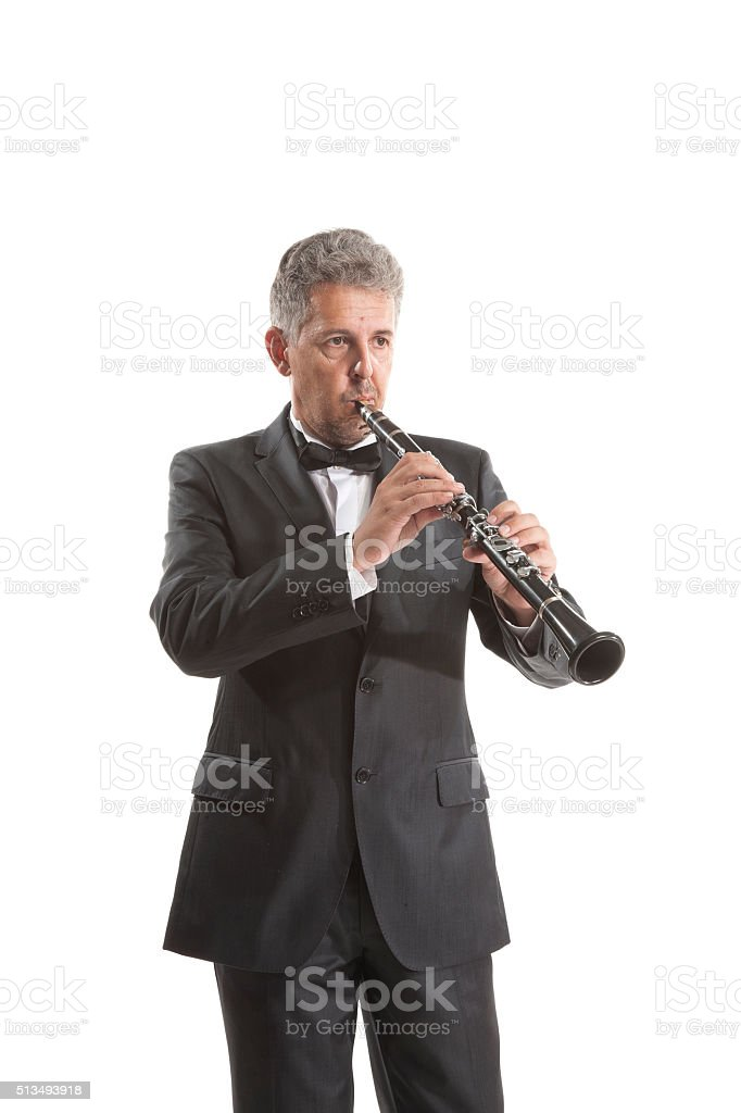 Adult man playing the clarinet stock photo