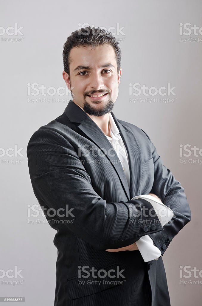 Adult man portrait with goatee posing in studio shot stock photo