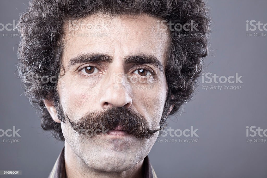 Adult man portrait with handle bar mustache stock photo