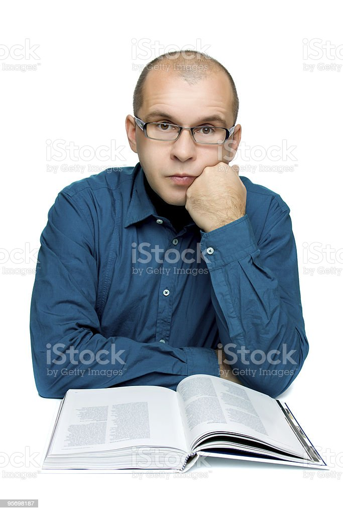 Adult man reading a book stock photo