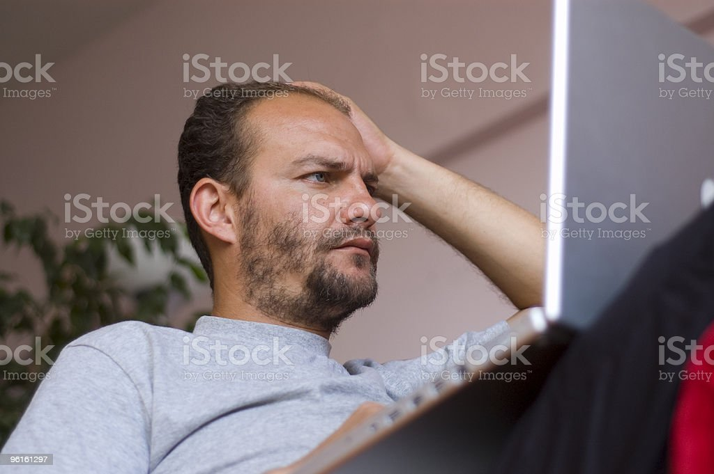 Adult man surfing on laptop computer royalty-free stock photo