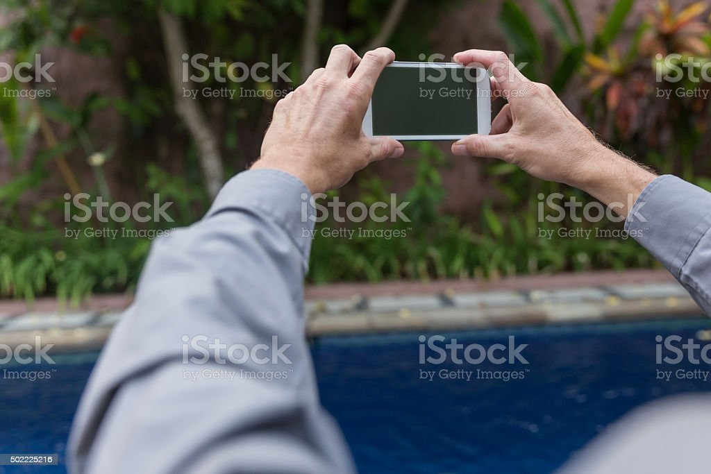 Adult man taking pictures stock photo