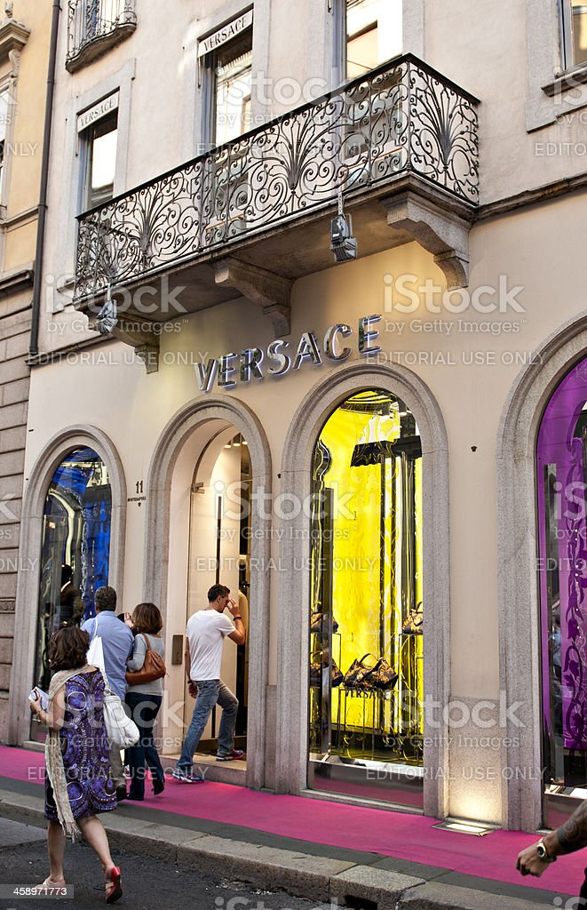 Adult man walks in to a Versace store stock photo