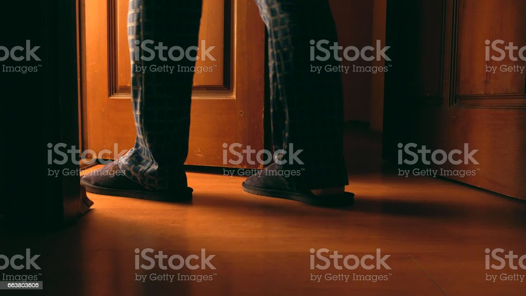 Adult man walks to a bathroom at the night stock photo