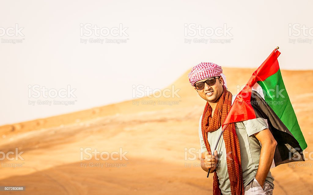 Adult Man with a UAE flag at Dunes of Dubai stock photo