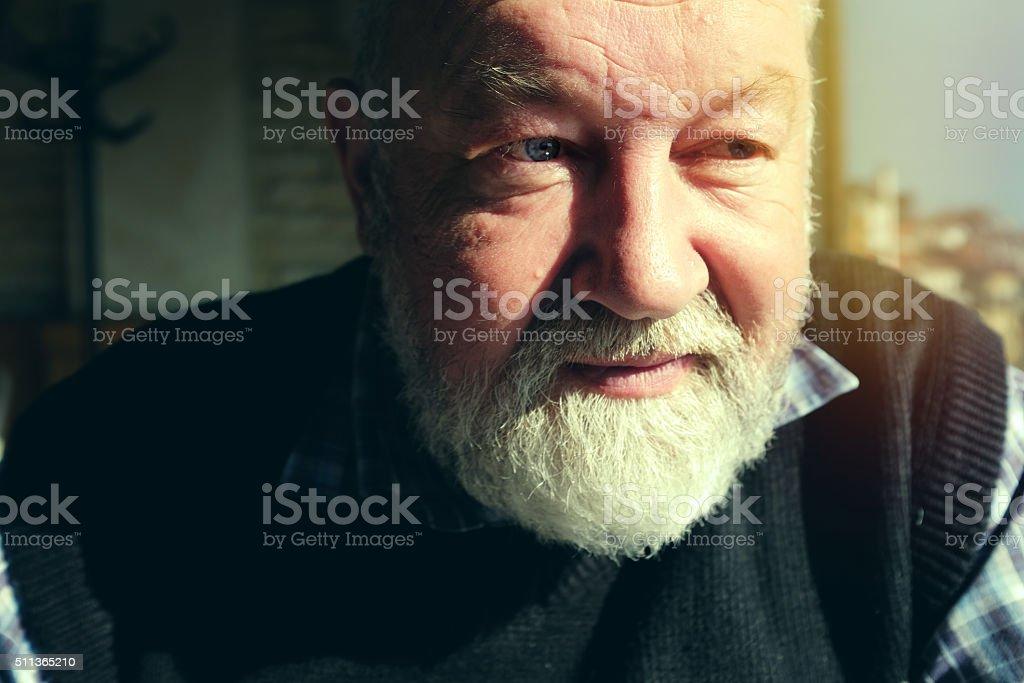 Adult man with white beard stock photo