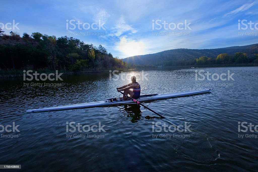Adult rower man on boat stock photo