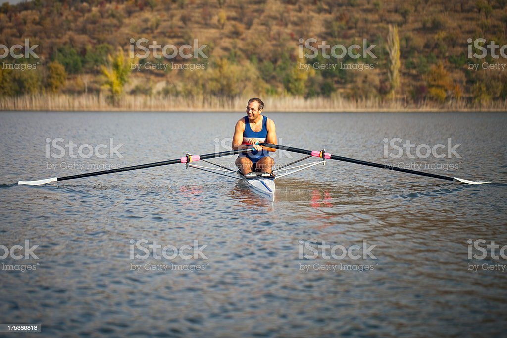 Adult Rower man resting on sculling boat stock photo