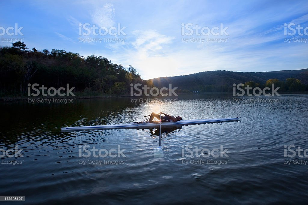 Adult Rower man resting on the boat stock photo