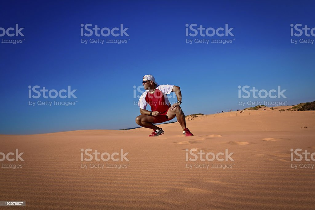 Adult runner on the sand dunes stock photo