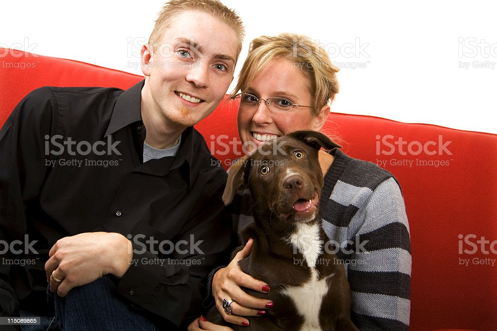 adult scene - young married couple and puppy royalty-free stock photo